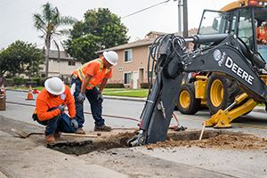 SWA staff reconnect service lateral to replaced water main